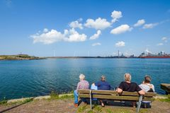 Retired people look across the water on the North Sea coast to m stock image