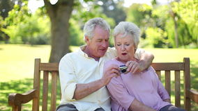 Retired people in love taking a picture together stock video footage