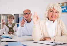 Retired people raising hands Stock Photos