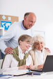 Retired people using laptop Stock Photo