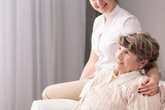 Retired person and caregiver Royalty Free Stock Images