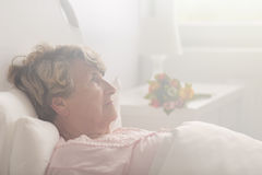 Retired person in hospital room Stock Images