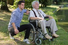 Retired person and male carer Royalty Free Stock Photos