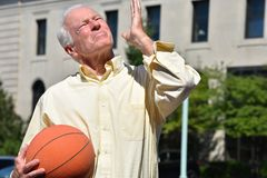 Athlete Senior Male Basketball Coach And Confusion With Basketball. A retired senior adult male stock image
