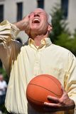 Male Basketball Coach And Anxiety. A retired senior adult male royalty free stock photography