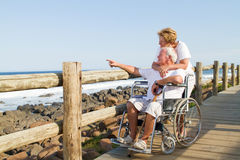 Retired senior couple. Happy loving retired senior couple hugging and viewing seascape Stock Photography