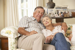 Retired Senior Couple Dozing On Sofa At Home Together Stock Photos