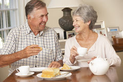 Retired Senior Couple Enjoying Afternoon Tea Together At Home Stock Photos