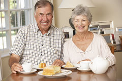 Retired Senior Couple Enjoying Afternoon Tea Together At Home Royalty Free Stock Images