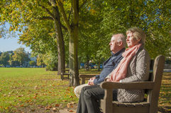 Retired senior couple outdoors Stock Images
