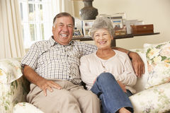 Retired Senior Couple Sitting On Sofa At Home Together Stock Image