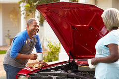 Retired Senior Couple Working On Restored Car Stock Photo