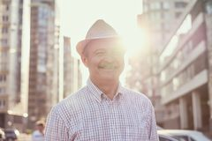 Retired senior hispanic man with hat standing and smiling royalty free stock photos