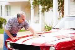 Retired Senior Man Cleaning Restored Car Stock Photos