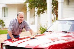 Retired Senior Man Cleaning Restored Car Royalty Free Stock Photo