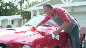 Retired Senior Man Cleaning Restored Classic Car
