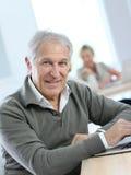 Retired senior man at informatics course Stock Image