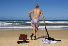 Retired senior man undressed on a caribbean beach, retirement freedom concept Royalty Free Stock Photos