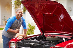 Retired Senior Man Working On Restored Car Royalty Free Stock Photo