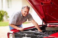 Retired Senior Man Working On Restored Car royalty free stock images