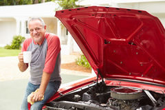 Retired Senior Man Working On Restored Classic Car Royalty Free Stock Image