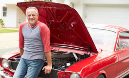 Retired Senior Man Working On Restored Classic Car Royalty Free Stock Images