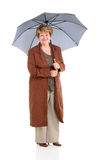 Retired senior woman umbrella Stock Photography