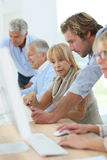 Retired seniors in computing class. Group of senior people attending computing class Stock Photo