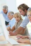 Retired seniors in computing class Stock Photo