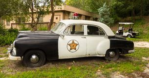 An old police car being used as decoration at a campground in florida. A retired sheriff`s vehicle parked at the entrance to an rv resort in ocala Royalty Free Stock Image
