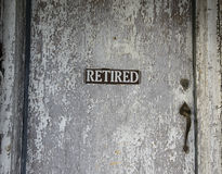 Retired Sign On Old Door Stock Photography