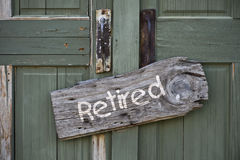 Retired sign on wooden door Royalty Free Stock Image