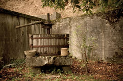 Retired Wine Press, France. Traditional Wooden Wine Press, retired with autumnal leaves around in the Jura, France Royalty Free Stock Image
