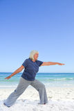 Retired woman doing her stretches Stock Photography