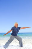 Retired woman doing her stretches Stock Image
