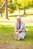 Retired woman doing her stretches Royalty Free Stock Image