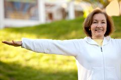 Retired woman doing yoga Royalty Free Stock Photos