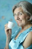 Retired woman drinking tea Royalty Free Stock Photography