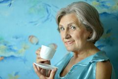 Retired woman drinking tea Stock Photos