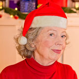 Retired woman Father Christmas hat Stock Image
