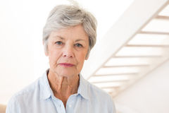 Retired woman frowning at the camera Stock Photo