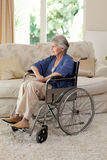 Retired woman in her wheelchair Stock Images