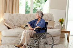 Retired woman in her wheelchair. At home Royalty Free Stock Image