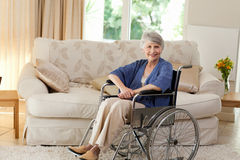 Retired woman in her wheelchair Royalty Free Stock Photography