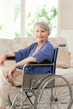 Retired woman in her wheelchair. At home Stock Image