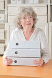 Retired woman holding files folders Royalty Free Stock Image