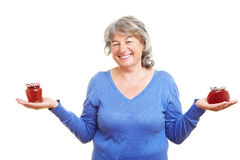 Retired woman with homemade jam Royalty Free Stock Photo