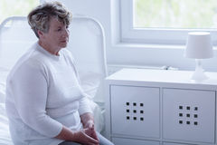 Retired woman in hospital room Royalty Free Stock Photography