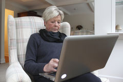 Retired Woman with Laptop Stock Photos