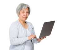 Retired woman learn to use laptop Stock Image
